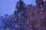 St. Francis Cathedral Posters - Snow Falls On A City Scene Poster by Ralph Lee Hopkins