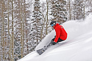 Ski Framed Prints - Snowboarder Enjoying Deep Fresh Powder At Brighton Ski Resort. Framed Print by Paul Kennedy