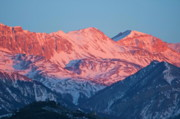 Snow-covered Landscape Prints - Snowy mountain range with a rosy hue at sunset Print by Sami Sarkis