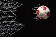 Soccer Ball Posters - Soccer Ball Breaking Through Goal Net Poster by Phillip Simpson Photographer