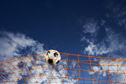 Soccer Goal Framed Prints - Soccer Ball Going Into Goal Net Framed Print by Fuse
