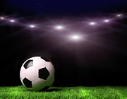 Black Light Blue Prints - Soccer ball on grass against black Print by Sandra Cunningham
