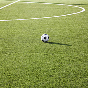 Soccer Ball Posters - Soccer Ball on Soccer Field Poster by Jetta Productions, Inc