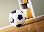Home Football Game Posters - Soccer Ball On Wood Floor Poster by Gualtiero Boffi