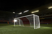 Soccer Goal Framed Prints - Soccer Goal In Empty Floodlit Stadium Framed Print by Tay Rees