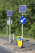 Solar Panel Prints - Solar Panels At A Traffic Island, Uk Print by Paul Rapson