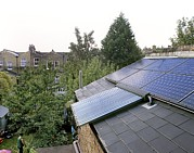 Solar Panel Prints - Solar Panels On House Roof Print by Martin Bond