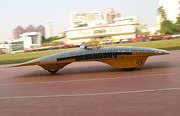 Grid Photos - Solar Powered Vehicle in Motion by Yali Shi