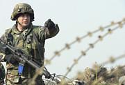 Soldier Calls Out Approaching Locals Print by Stocktrek Images