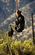Grasp Photo Posters - Soldier Climbs Down The Back Rope Poster by Stocktrek Images