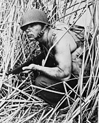 Hiding Photos - Soldier In Grass, Circa Early 1940s by Everett