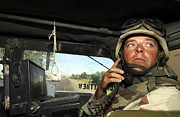 On The Phone Prints - Soldier Monitors The Progress Of A 67 Print by Stocktrek Images