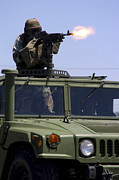 Live Fire Posters - Soldier Shoots A M-240b Machine Gun Poster by Stocktrek Images
