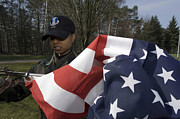 Soldier Unfurls A New Flag For Posting Print by Stocktrek Images