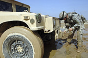 Problems Posters - Soldier Unties A Rope To Tow A Humvee Poster by Stocktrek Images