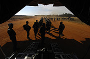Battlefield Photos - Soldiers Board A C-130 Hercules by Stocktrek Images