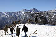 Snow Boarding Prints - Soldiers Board A U.s. Army Uh-60 Black Print by Stocktrek Images