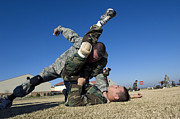 Grapple Framed Prints - Soldiers Demonstrate Proper Grappling Framed Print by Stocktrek Images