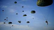 Paratrooper Photo Prints - Soldiers Descend Under A Parachute Print by Stocktrek Images