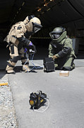 Body Armor Art - Soldiers Dressed In Bomb Suits Examine by Stocktrek Images