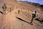 Foot Patrol Photos - Soldiers Patrol To A Village by Stocktrek Images