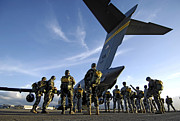 Adults Prints - Soldiers Prepare To Board A C-17 Print by Stocktrek Images