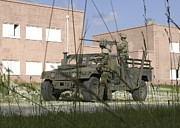 Hmmwv Posters - Soldiers Provide Perimeter Security Poster by Stocktrek Images