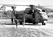 Four People Posters - Soldiers Run To A Hh-53c Helicopter Poster by Stocktrek Images