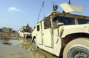 Problems Posters - Soldiers Work To Remove Their Humvees Poster by Stocktrek Images
