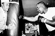 Punching Framed Prints - Sonny Liston Working Out On The Heavy Framed Print by Everett