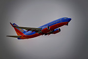 Airplane Photo Posters - Southwest Departure Poster by Ricky Barnard