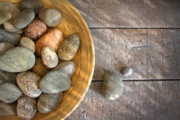 Grey Posters - Spa rocks in wooden bowl on rustic wood Poster by Sandra Cunningham