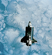 Space Ships Glass - Space Shuttle Orbiting Above Earth by Stockbyte