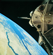Satellite View Posters - Space Shuttle Orbiting The Earth Poster by Stockbyte