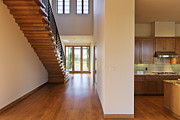Leed Certified Framed Prints - Spacious Hallway Showing a Staircase and Modern Kitchen Framed Print by Jeremy Woodhouse