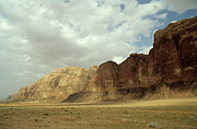 Desert Prints - Sparse tussock and rock formations in the Wadi Rum desert Print by Sami Sarkis