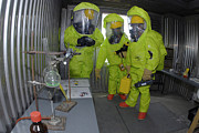 Protective Clothing Prints - Specialists Survey A Simulated Area Print by Stocktrek Images