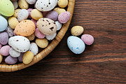 Small Basket Posters - Speckled chocolate easter eggs in a basket  Poster by Richard Thomas