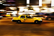 Speeding Taxi Framed Prints - Speeding yellow taxi cab Framed Print by Asaf Brenner