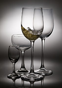 Champagne Photo Prints - Splashing Wine In Wine Glasses Print by Setsiri Silapasuwanchai