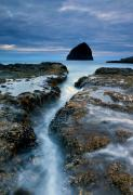 Haystack Rocks Prints - Splitting Stone Print by Mike  Dawson