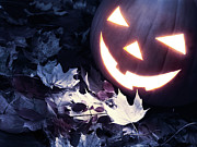 Carved Pumpkin Prints - Spooky Jack-o-lantern on Fallen Leaves Print by Oleksiy Maksymenko