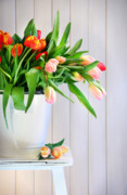 Florist Posters - Spring tulips on an old bench Poster by Sandra Cunningham