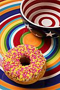 Donuts Prints - Sprinkled donut on circle plate with bowl Print by Garry Gay