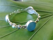 White Topaz Jewelry - SS Bangle with Ice Blue Tumble Glass Marble by fmnjewel - Fernando Situmeang