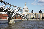 Christianity Photo Framed Prints - St Pauls Cathedral And Millennium Bridge Framed Print by Richard Newstead