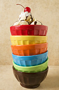 Topping Prints - Stack of colored bowls with ice cream on top Print by Garry Gay