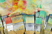 Creativity Art - Stack of colorfull paintbrushes on palette by Sami Sarkis