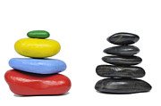 Stability Posters - Stack of multi-colored and black pebbles Poster by Sami Sarkis