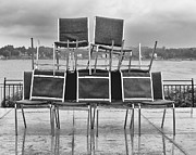 Futility Prints - Stacked Chairs on Wet Plaza  Print by Gary Slawsky